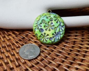 Stamped blues and greens pendant