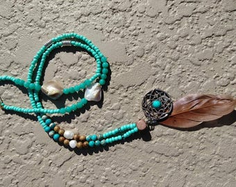 Dream catcher and feather pendant with turquoise seed beads and shell accents