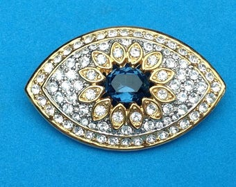 "Vintage! Well made gold tone clear & deep sapphire blue rhinestone pin - 2"" x 1 1/8""."