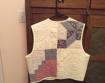 Hand quilted vest made from vintage quilt.