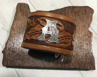 "Brown leather band with initial ""A"""