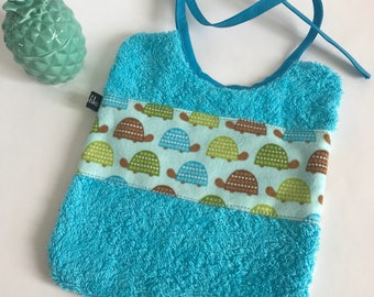 Blue turtles baby bib