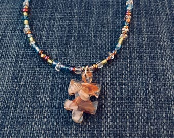 Beaded Necklace with Puzzle-Shaped Lake Superior Agate Pendate