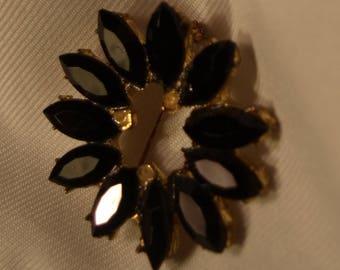 Beautiful petals in black stone vintage brooch