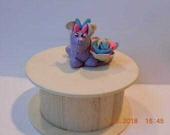 Beautiful pastel sitting clay dragon