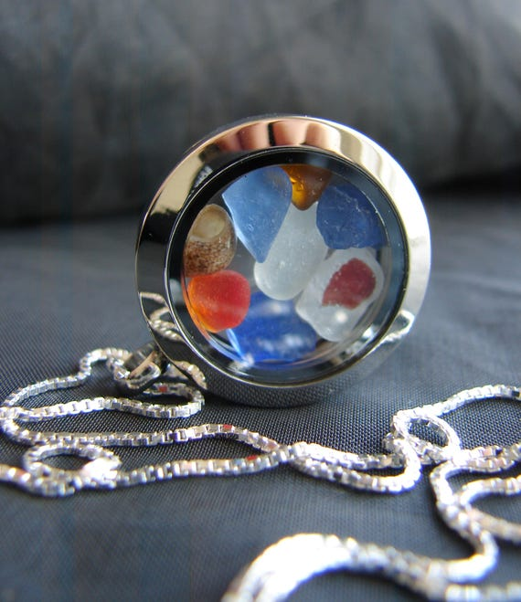 Porthole locket in blue, amber and red