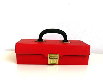 Vintage cassette tape carrying case. Portable music storage in red with metal insert for 12 tapes. Faux Leather Car cassette holder.