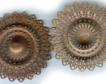 vintage RAW BRASS circle filigree shapes, very ORNATE design and puffy middle two brass findings
