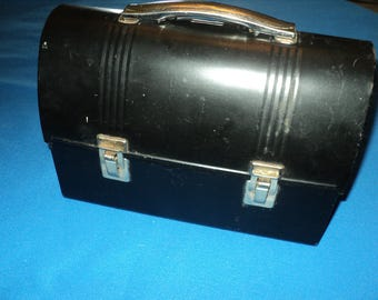 Vintage Black Lunch Bucket With Thermos That Is Blue With Red Lines