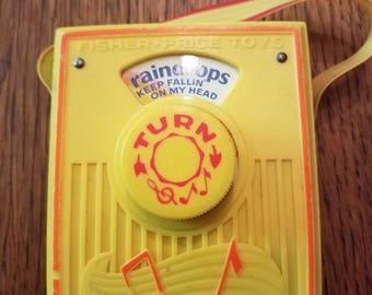 Vintage 1972 Fisher Price Pocket Radio Music Box Raindrops Keep Falling on my Head