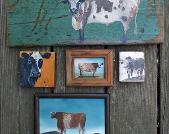 Collection of cows on old wood