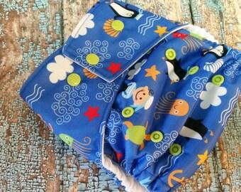 One Size Pocket Cloth Diaper Playful Peguins 15-40 lbs