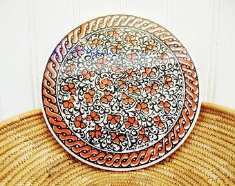 vintage trivet round ceramic tile artist signed red and black
