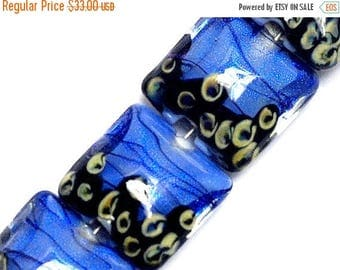 ON SALE 30% off Four Arctic Blue Shimmer Pillow Beads - 10413414 Glass Lampwork Bead Set