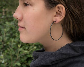 Big sterling silver hoop earrings/ 55mm/ Matte black/ Unique, large, oxidized hammered hoops/ Minimalist gift for women/ Handcrafted modern