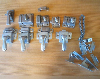 LOT of Vintage used Metal cabinet latches. 9 latches / 7 keepers / odds and ends / Original patina with a spotted dark metal patina .