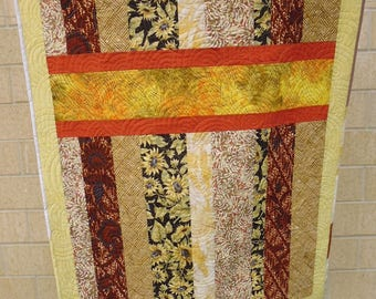 Yellow and orange crib or lap quilt, with orange horizontal stripes
