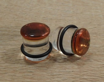 Glass plugs 5/8 inch amber and clear glass plugs 5/8 gauge
