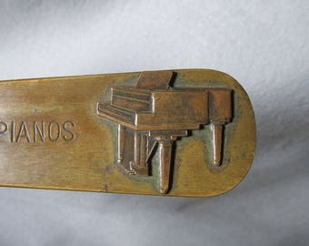 Antique Bronze Desk ,Letter Opener with Piano Advertisement, Grand Piano