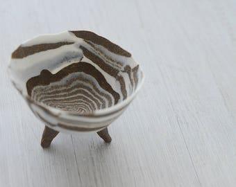 Nerikomi stripped tripod bowl, bare clay.