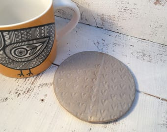 Handmade ceramic coaster, teapot stand, candle stand, bespoke loveheart design