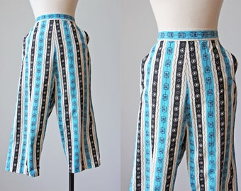 50s Pants - Vintage 1950s Capri Pants M -  Turquoise Black Atomic Print Cotton Cropped Clamdiggers Pants M - Drum and Wheel Capris
