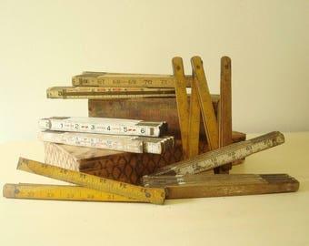 7 folding yardstick collection, white wood, natural wood, vintage expansion ruler display, Lufkin & Empire, carpenter's tool, builders gift