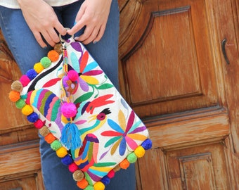 Multi colored Otomi clutch with pompoms and hand embroidered tassels