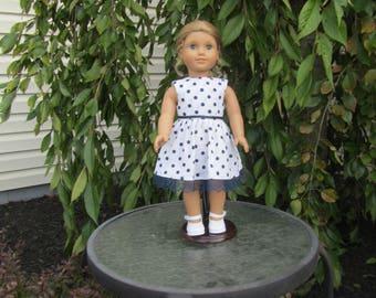 Polka dot dress fits dolls like American Girl