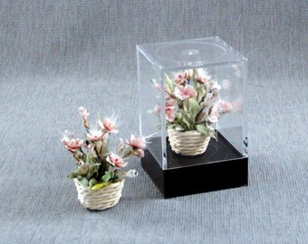 Light Peach flower arrangement in a wicker basket all inside an acrylic showcase box