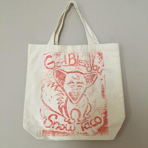 Canvas Tote Bag, God Bless You Snow Taco, Linoleum Block Print,  american eskimo, dog