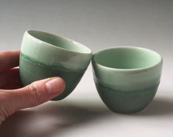 Pair of teal ceramic espresso cups