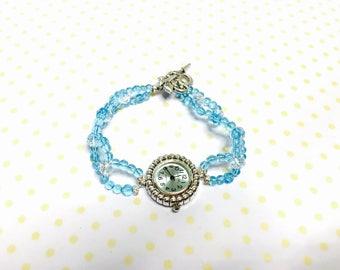 Light blue watch/Bracelet beaded, silver tone, flower clasp, vintage inspired, item no. L116
