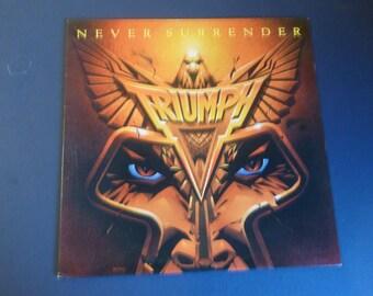Triumph Never Surrender Vinyl Record LP AFL1-4382 RCA Records 1983
