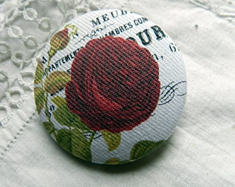 Fabric design with red rose bud, 1.25 in / 32 mm