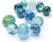 Handmade lampwork glass bead set of 12 mainly teal renegade beads - lampwork orphan beads