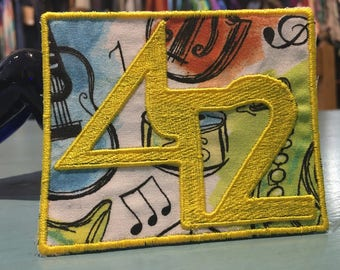 The Disco Biscuits 42 Patch Multicolored Instrument themed fabric and Yellow Embroidery