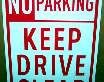 No Parking Keep Drive Clear on an 8x12 Aluminum Sign Made in USA UV Protected