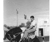 """Vintage  Snapshot """"Embarrassed By Dad"""" Nerdy Father Cowboy Hat In Hand Rides Stuffed Bronco Little Boy Cringes Old Found Photo"""