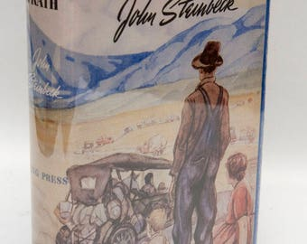 "John Steinbeck, ""The Grapes of Wrath"" Vintage Modern Library, c. 1948, in First Edition Facsimile Dust Jacket, American History, 1930s"