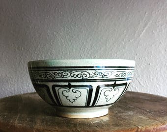 Vintage bowl with fish design