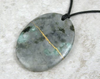 Kintsugi (kintsukuroi) emerald stone oval pendant with gold repair on black cotton cord - OOAK