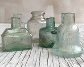 5 beautiful vintage ink bottles, blue green and clear. Collectable to use or for display. Rectangular, circular, bell shaped and oval.