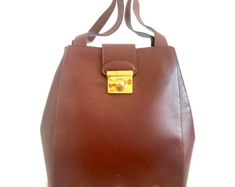 Vintage Salvatore Ferragamo brown leather purse with gold tone elegant closure. Featuring Ferragamo charms.