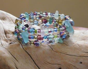 Genuine sea glass in a memory wire bracelet.  Surrounded by ocean colors and sea vibe.  Genuine Beach glass.  Unaltered.  Natural.