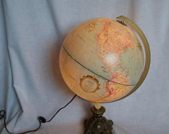 Vacay SALE...ships 7/8... World Globe lamp...light up Replogle World Globe...12 inches in diameter…up cycled with ornate brass base.