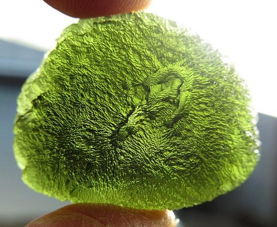 Beautiful 21.8 gram Moldavite. Self standing no damage. From the Czech Republic.