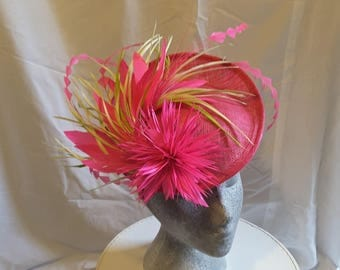 Fushia pink hat flower and feathers
