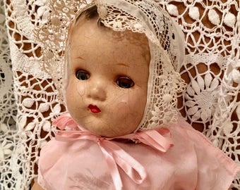 Vintage composition  baby doll, old dress, original shoes, socks. painted hair, sleepy eyes