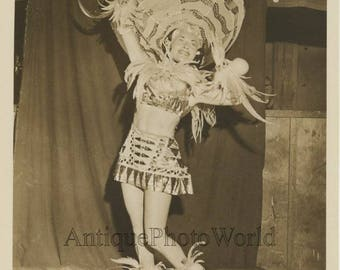 Woman circus performer in Indian Native American feather costume vintage photo